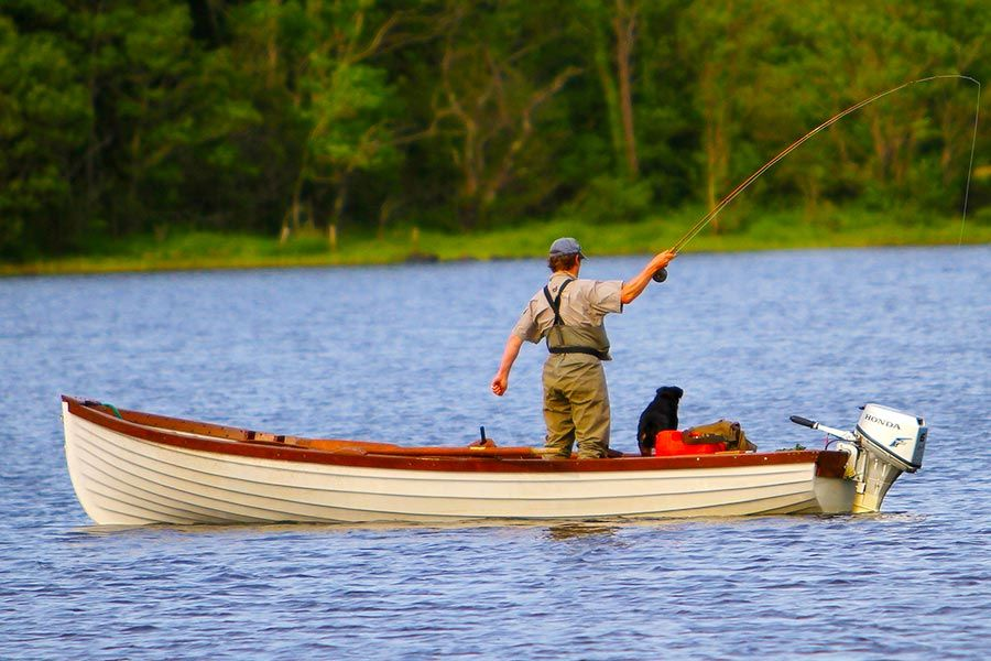 Man and dog fishing on a lake